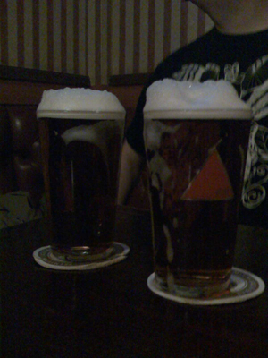 11/12/2008 - post-gig, well-earned pints with MASSIVE HEADS!